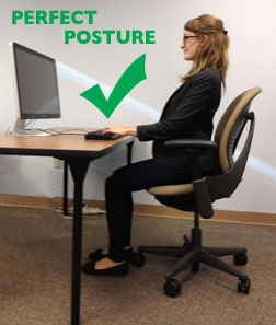 Perfect Desk Posture with feet flat on floor, straight back, and shoulders back